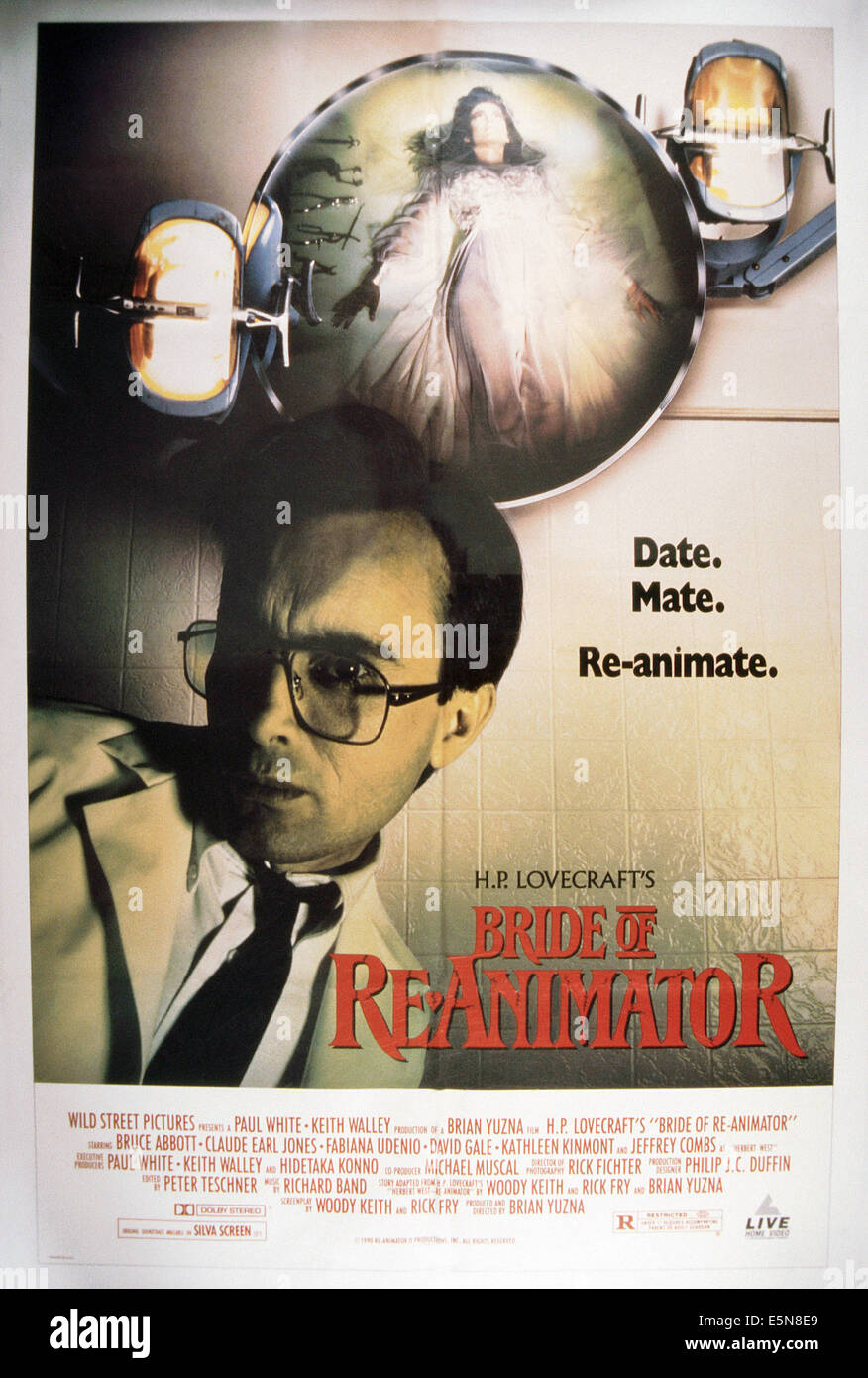 BRIDE OF RE-ANIMATOR, Jeffrey Combs (bottom), 1989, © 50th Street Films/courtesy Everett Collection - Stock Image