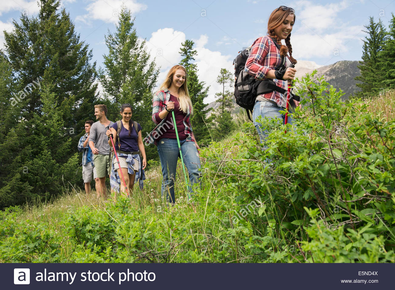 Friends hiking on trail - Stock Image