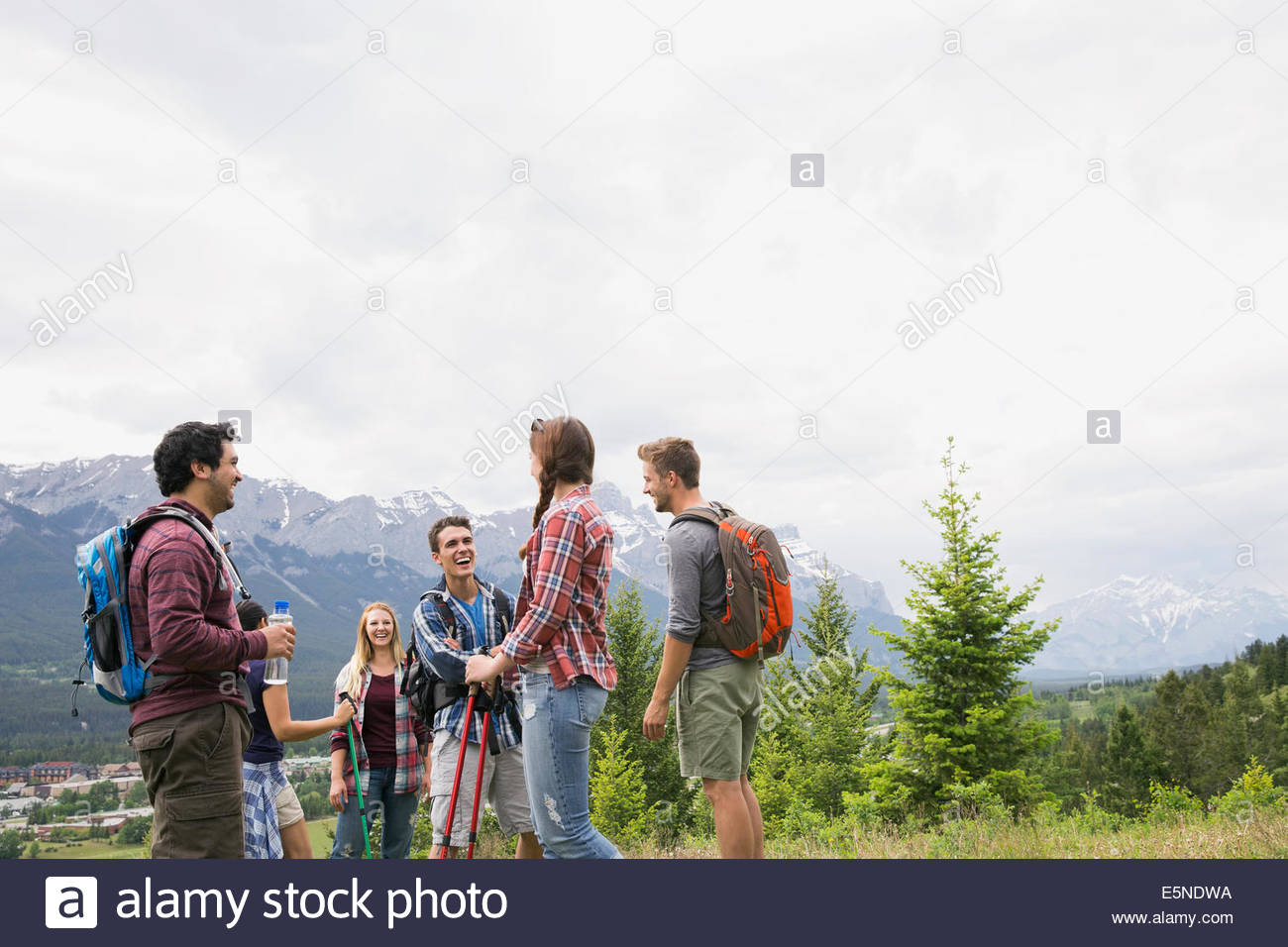 Friends hiking near mountains - Stock Image