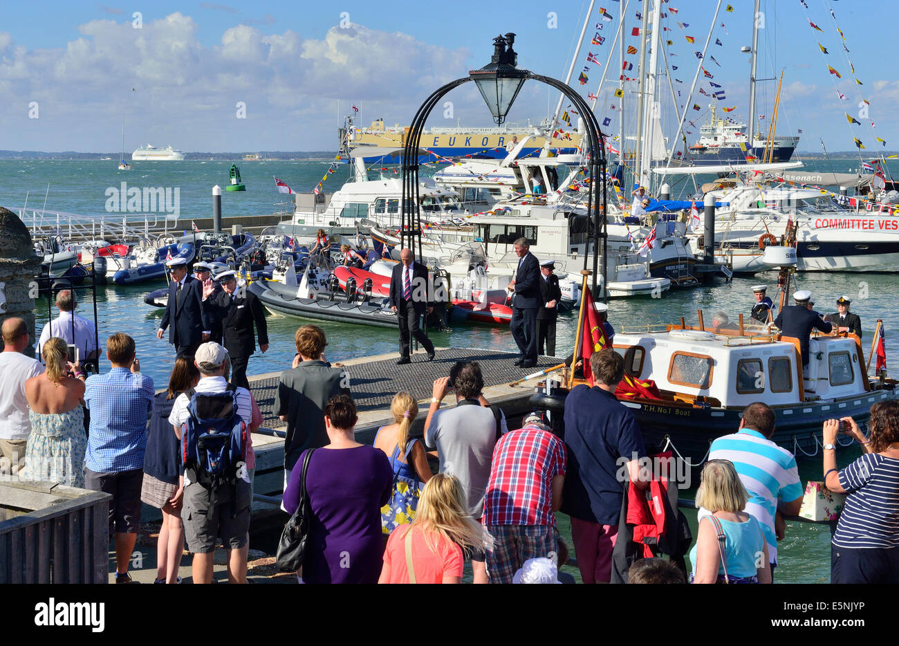 Prince Philip arriving at the Royal Yacht Squadron landing stage from THV Galatea,  -in distance on right . Trinity - Stock Image