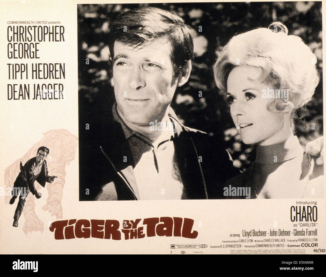 TIGER BY THE TAIL, US lobbycard, from left: Christopher George, Tippi Hedren, 1970 - Stock Image