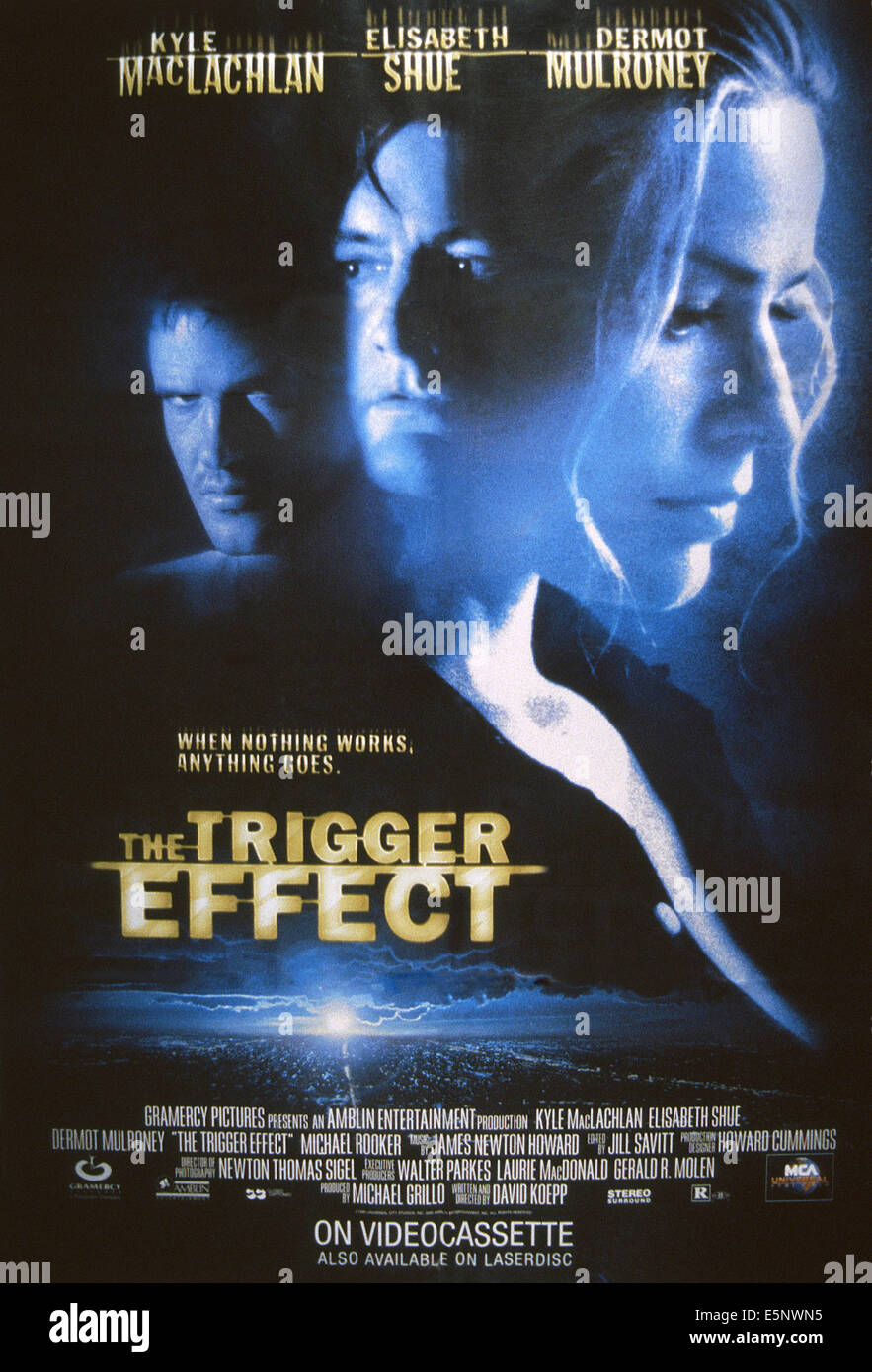 THE TRIGGER EFFECT, US poster art. from left: Dermot Mulroney, Kyle MacLachlan, Elisabeth Shue, 1996. ©Gramercy