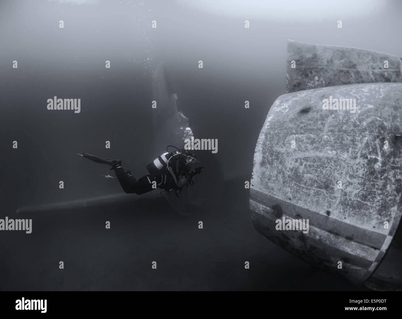 Scuba diver diving on an aeroplane wreck, Capernwray, UK - Stock Image