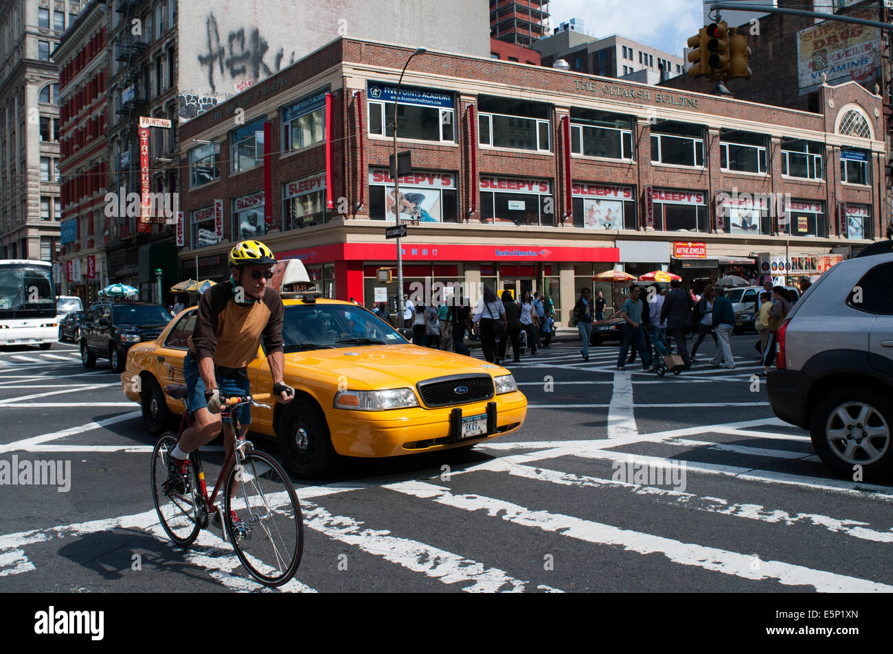 Man riding bicycle on city street. bicycling, bike, biker, biking, blurry, bringing, cab, citylife, color, colour, - Stock Image