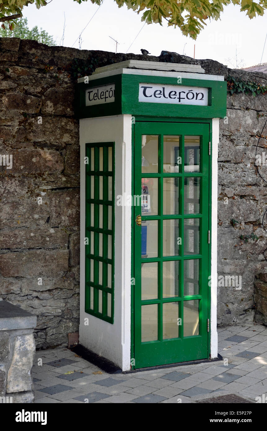 An old-fashioned Irish public telephone box in the historic village of Cong in County Mayo, Ireland - Stock Image