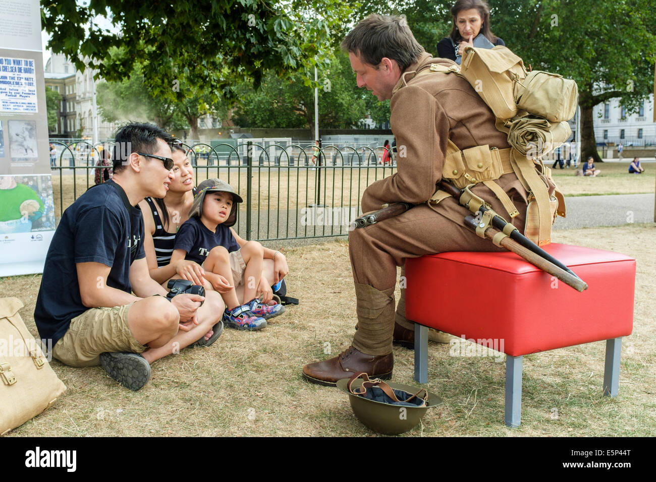 A historic storyteller dressed in the WW1 uniform of a British soldier tells visitors what life was like in the - Stock Image