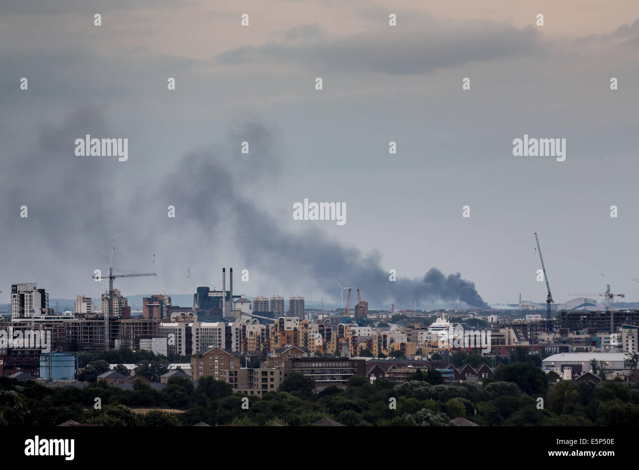Rainham, London. 4th Aug, 2014. Huge fire at recycling plant on Creek Way Credit:  Guy Corbishley/Alamy Live News Stock Photo