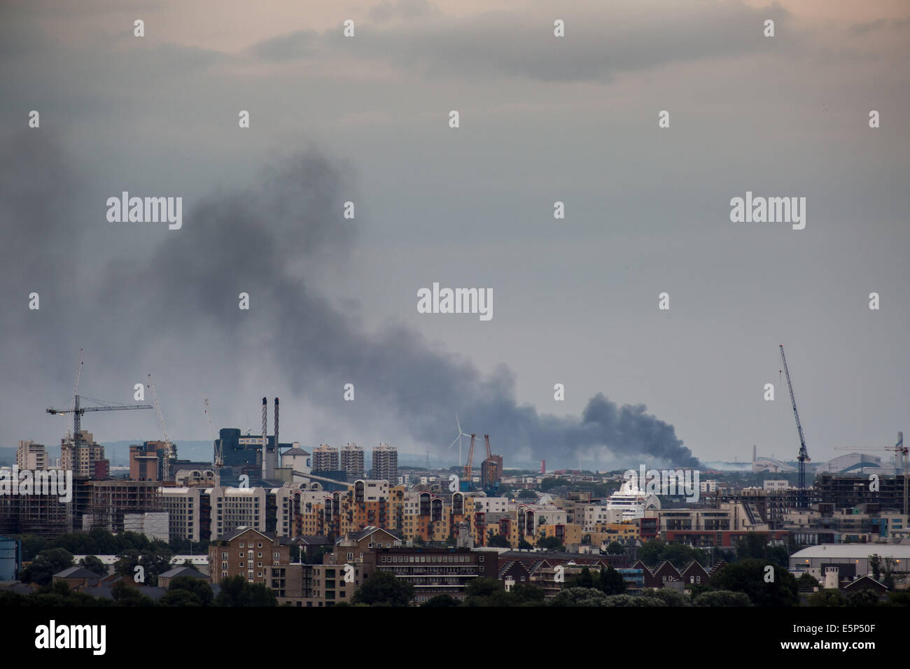 Rainham, London. 4th Aug, 2014. Huge fire at recycling plant on Creek Way Credit:  Guy Corbishley/Alamy Live News Stock Photo