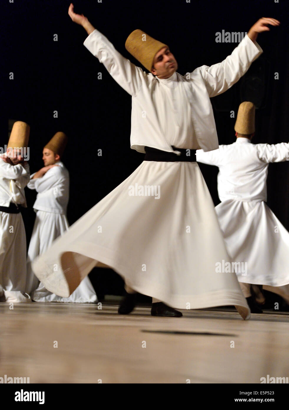 ISTANBUL, TURKEY - DECEMBER 14: Sufi whirling dervish (Semazen) dances, Commemoration of Mevlana Jalaluddin Rumi - Stock Image