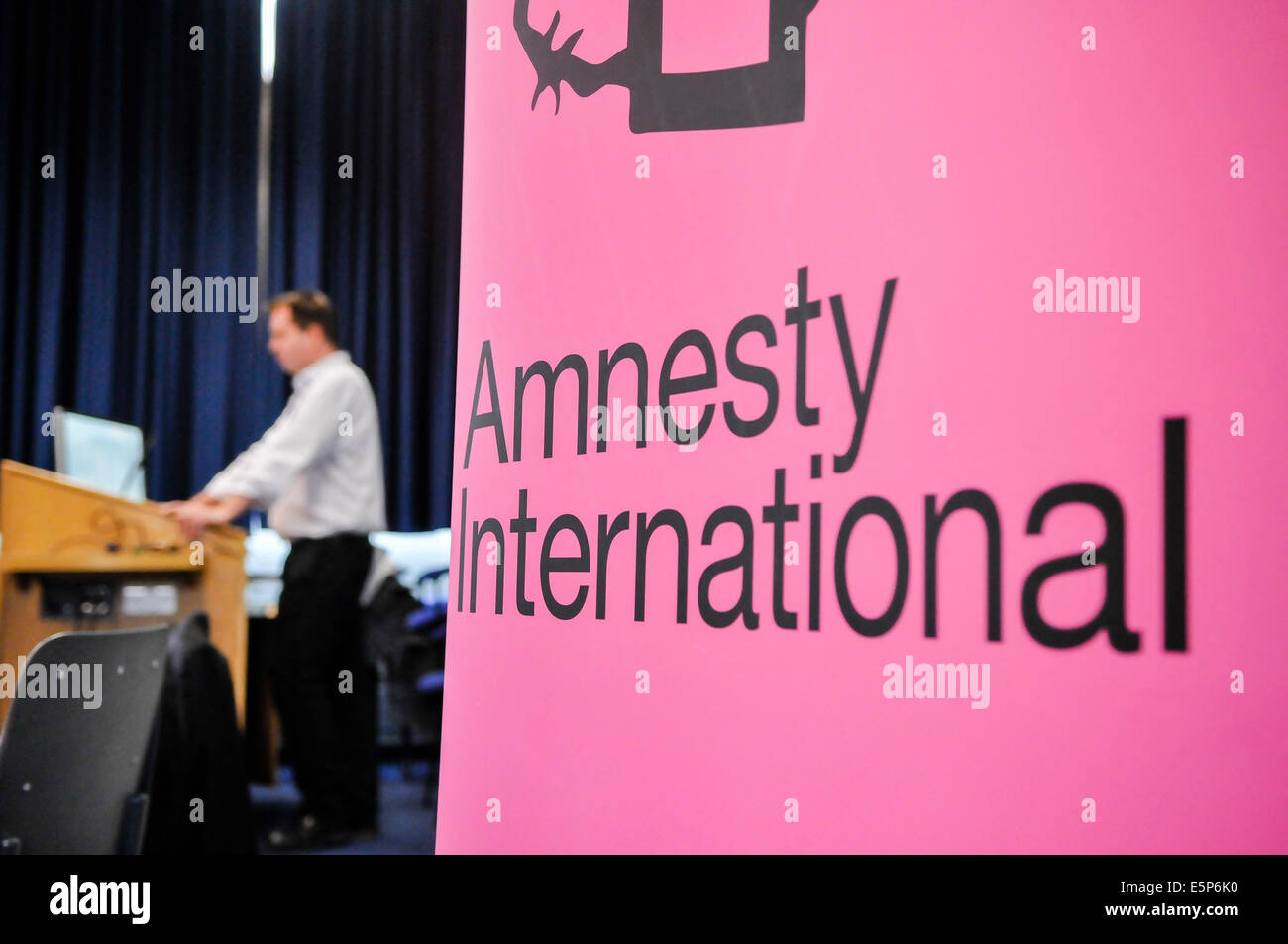 Belfast, Northern Ireland. 4th Aug, 2014.  A man delivers a speech for Amnesty International Credit:  Stephen Barnes/Alamy - Stock Image