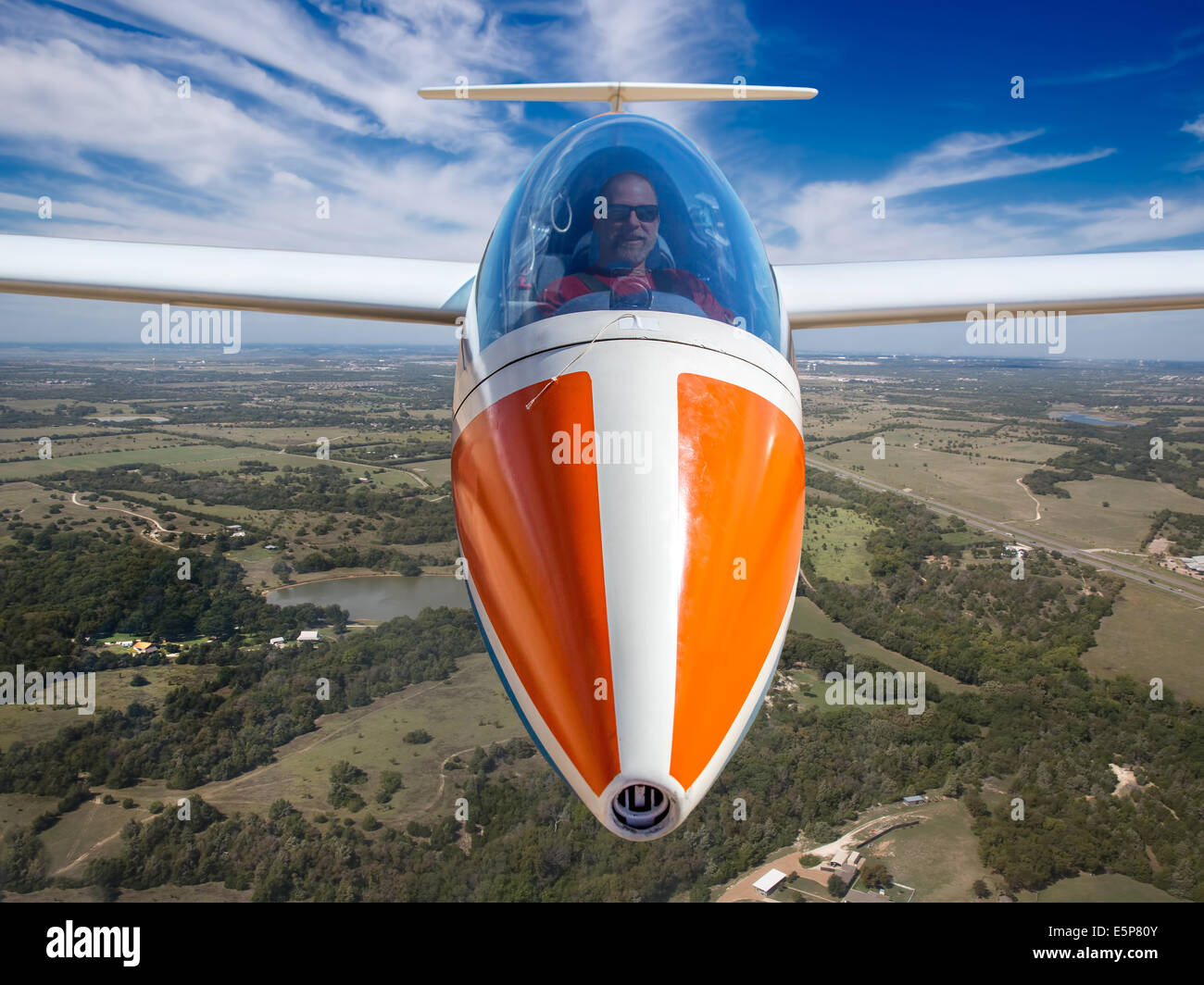 Front view of Sailplane in flight with view of Pilot - Stock Image
