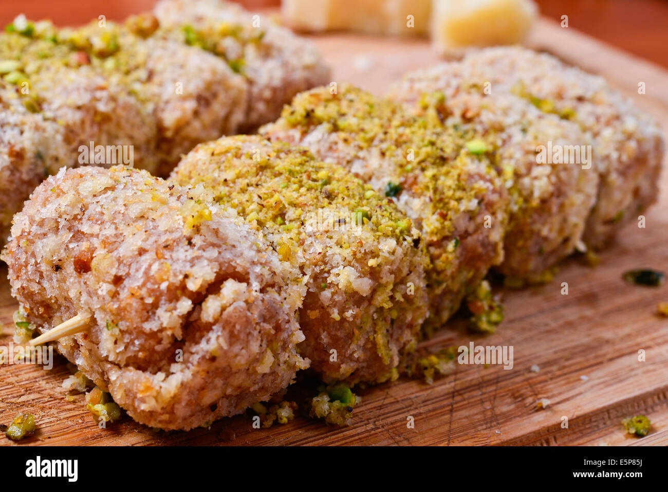 meat rolls with cream cheese and pistachio - Stock Image