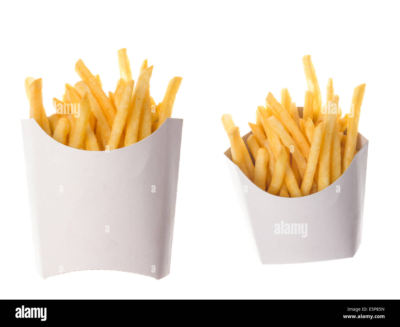 french fries in a paper wrapper on white background; two portions of french fries - Stock Image
