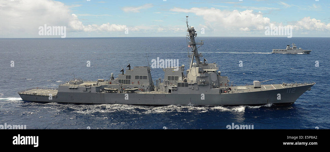 US Navy Arleigh Burke-class guided missile destroyer USS Michael Murphy, foreground, steams alongside the Royal - Stock Image