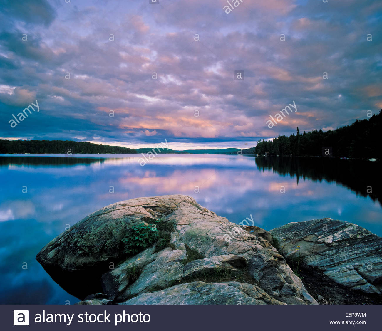 Smoke Lake at sunrise in Algonquin Provincial Park on the Canadian Shield in Ontario Canada - Stock Image