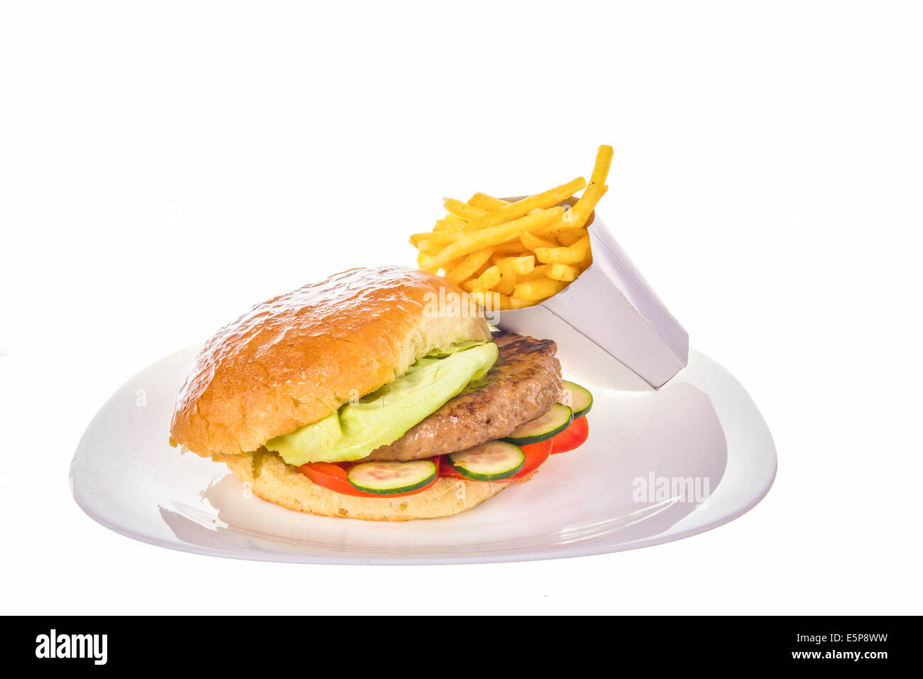 hamburger with salad and french fries on the side isolated on white plate - Stock Image