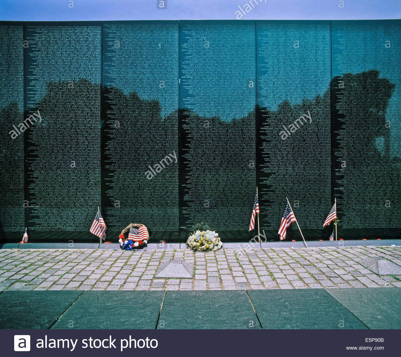 Names of war dead and missing in action etched on the Vietnam Veterans Memorial Wall in Washington DC USA - Stock Image