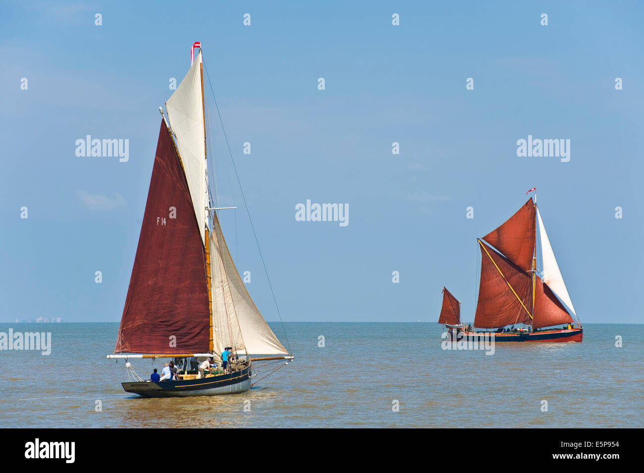 Vintage oyster smack & Thanes Barge sailing in regatta during Whitstable Oyster Festival Kent England UK - Stock Image