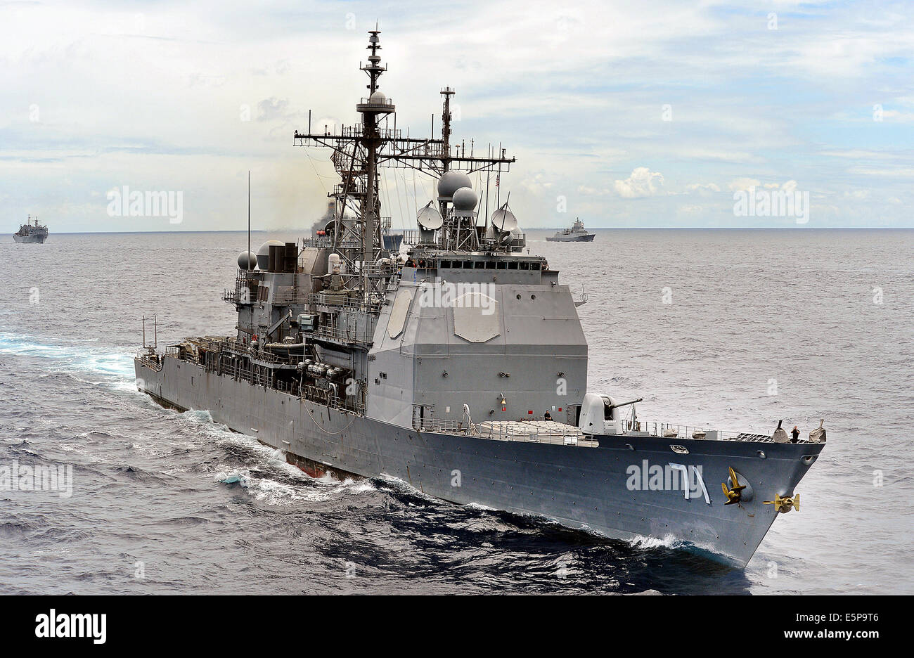 A US Navy Ticonderoga-class guided missile cruiser USS Cape St. George in formation during Rim of the Pacific Exercise - Stock Image