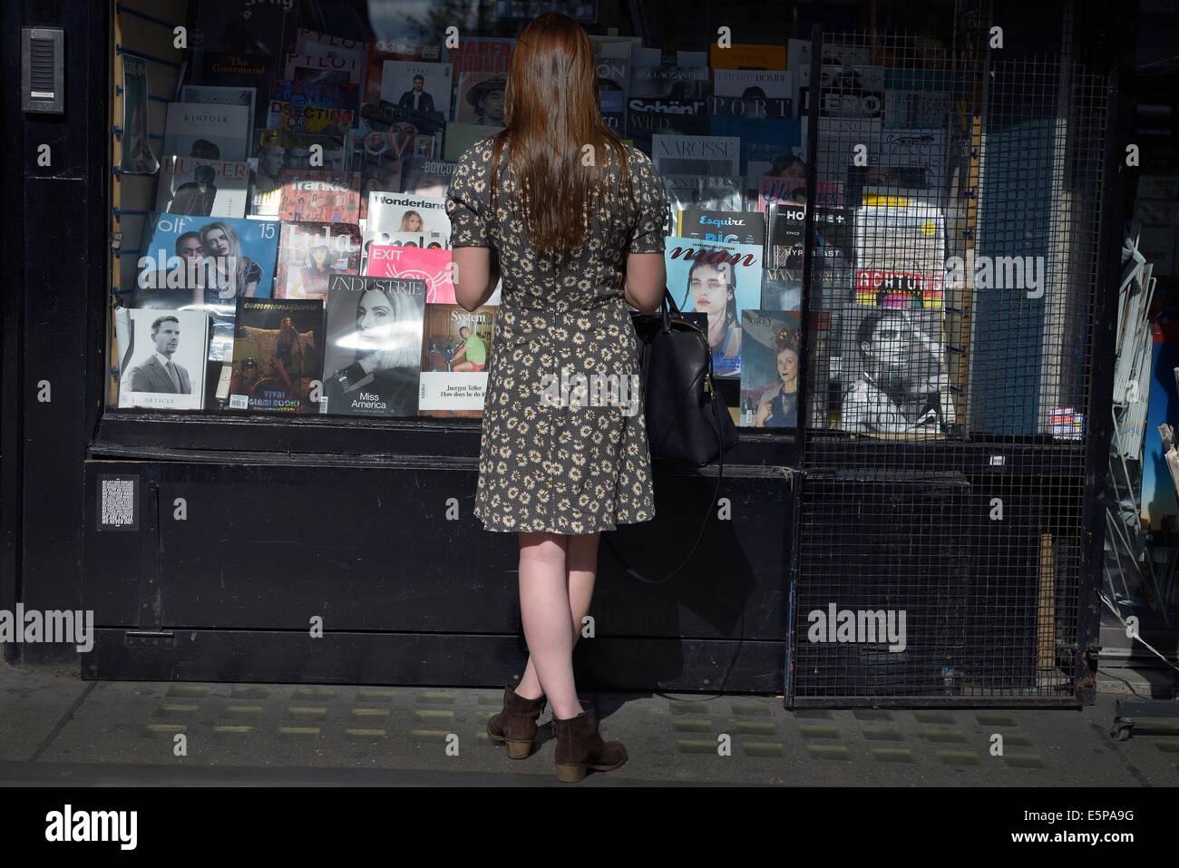 london wardour street newsagent woman looks Stock Photo