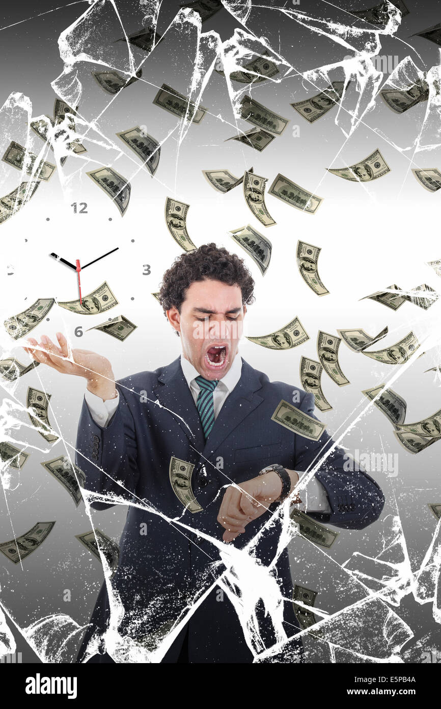 Man behind broken glass measuring time surrounded by falling money, Stressed businessman looking at watch losing Stock Photo