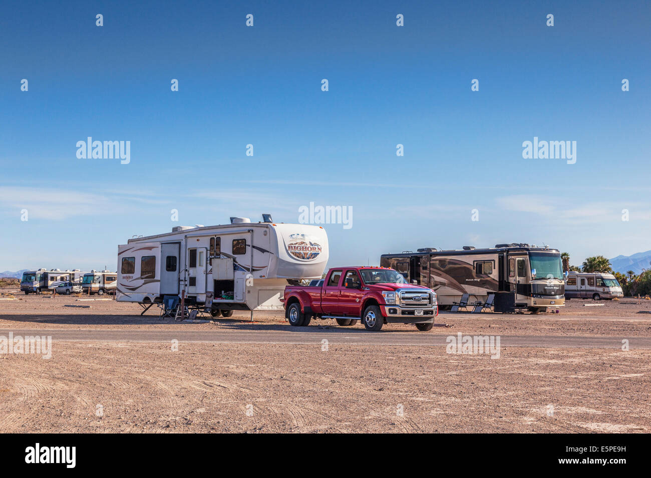 Large American motorhomes and fifth wheelers at Furnace Creek campground, Death Valley, California. - Stock Image
