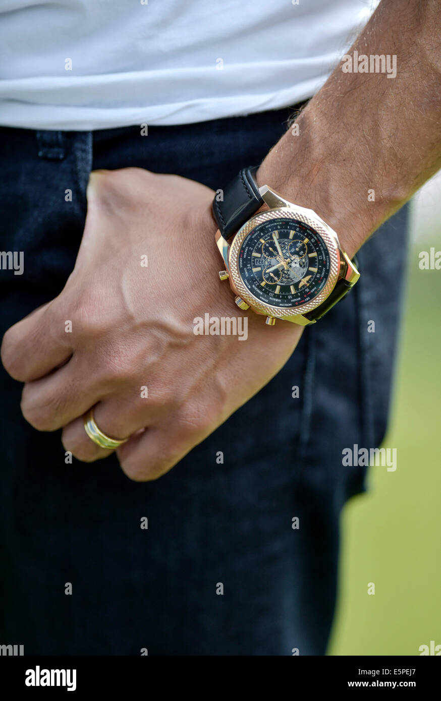 A man's hand with a Breitling watch and a wedding ring - Stock Image