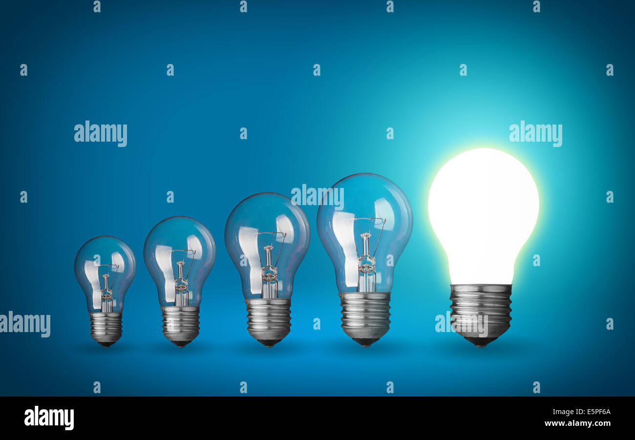 Row of light bulbs.Idea concept on blue background. - Stock Image