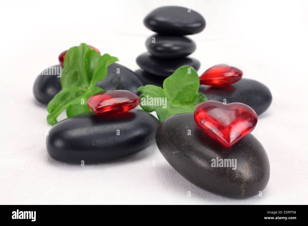 A pile of balanced black spa therapy stones - Stock Image