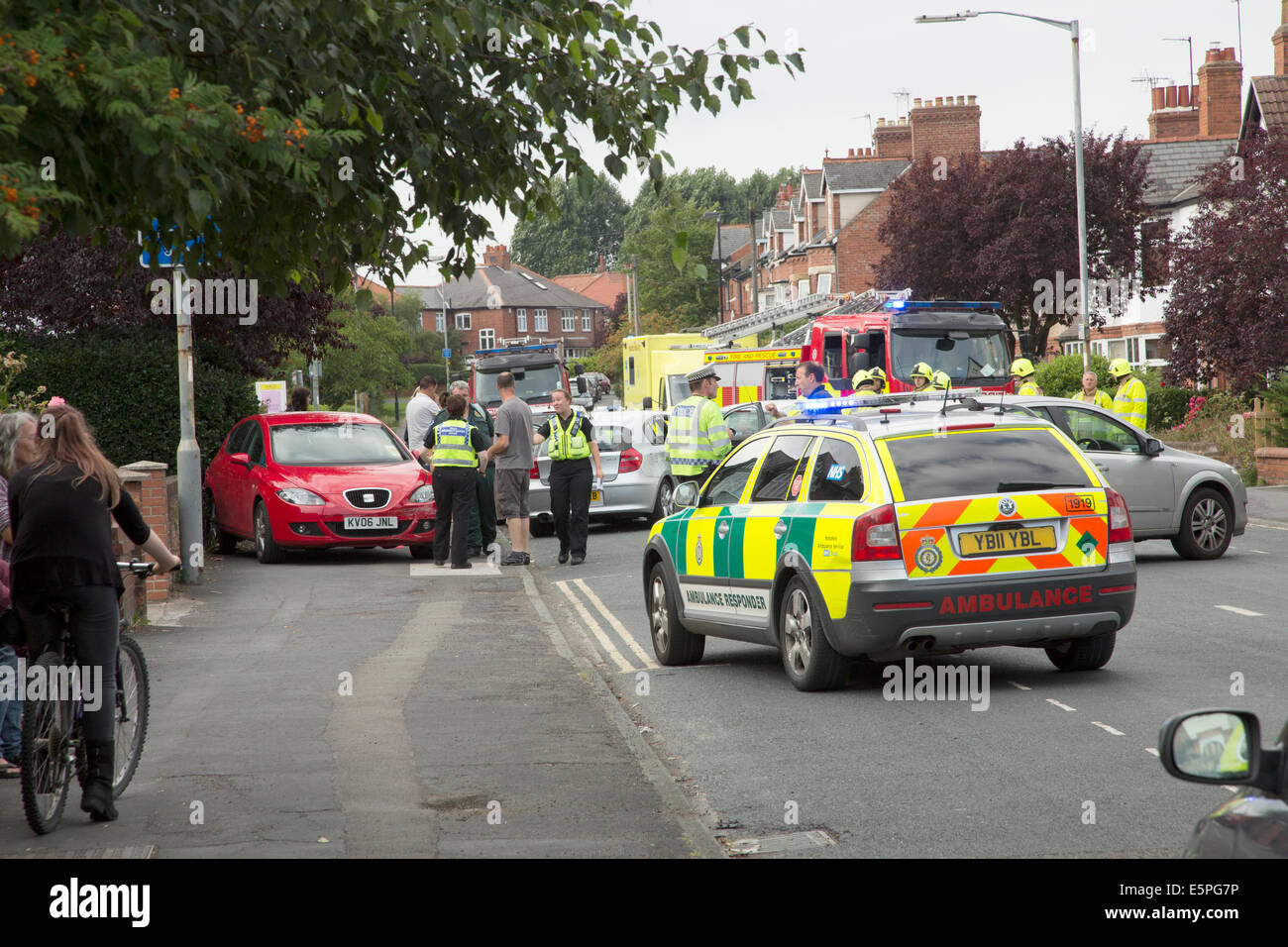 Road accident scene on a busy residential street in York, North ...