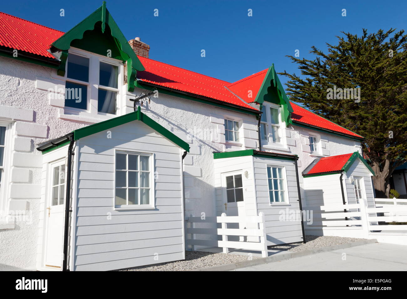 Red and white stone houses of Marmont Row, Victory Green, Stanley, Port Stanley, East Falkland, Falkland Islands, - Stock Image