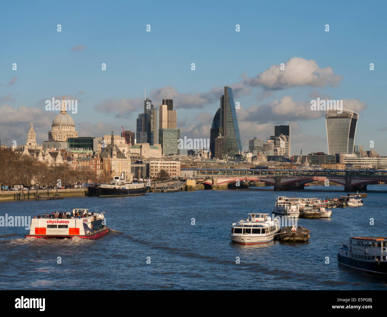 Classic cityscape across Blackfriars Bridge shows City CBD and St. Pauls Cathedral, London, England, United Kingdom, - Stock Image