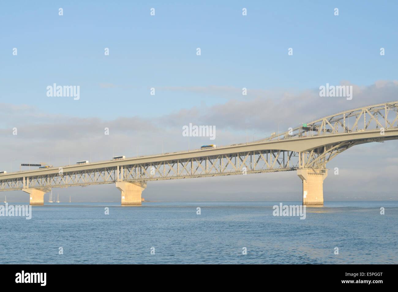 Auckland Harbour Bridge in morning sun - Stock Image