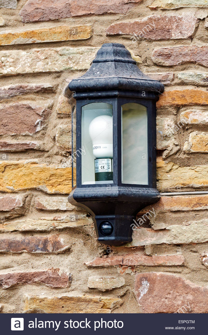 Black outside wall security light fixed to stone building with black outside wall security light fixed to stone building with energy saving light bulb aloadofball Image collections