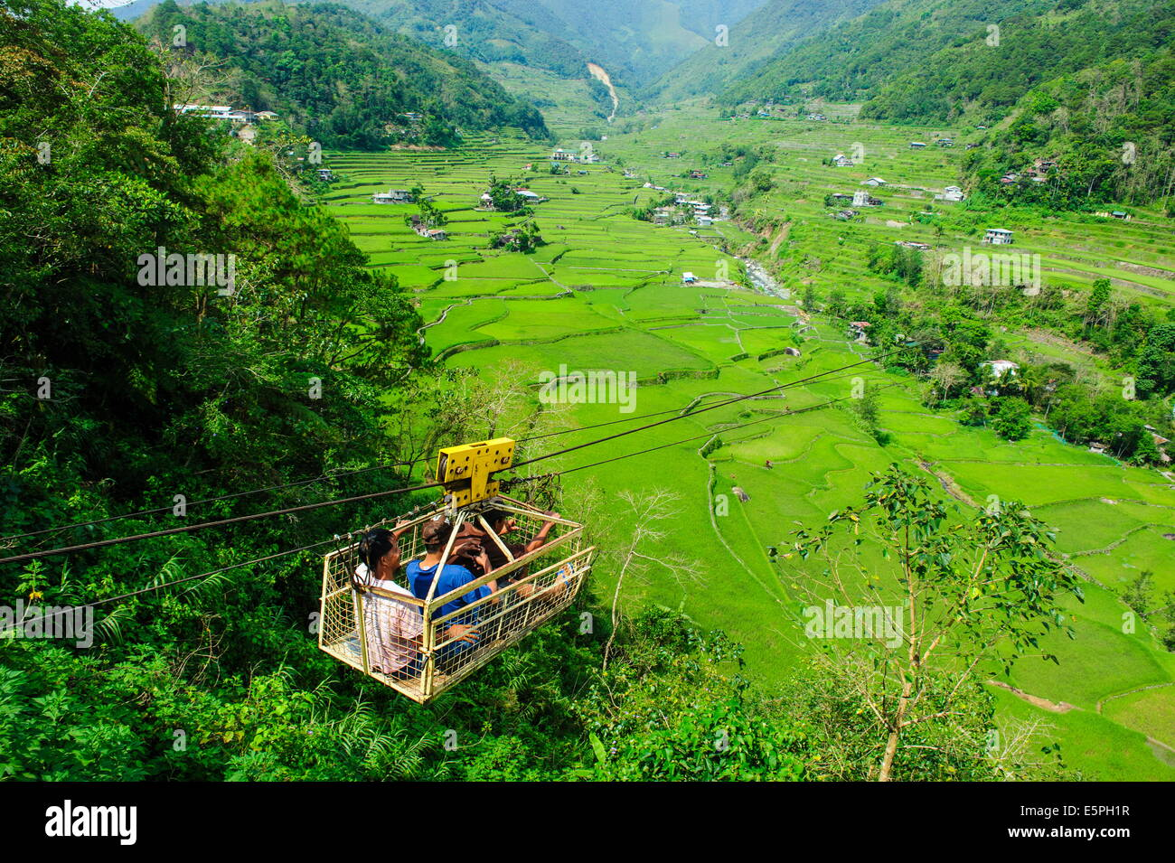 Cargo lift transporting people across the Hapao rice terraces, Banaue, UNESCO Site, Luzon, Philippines, Southeast - Stock Image