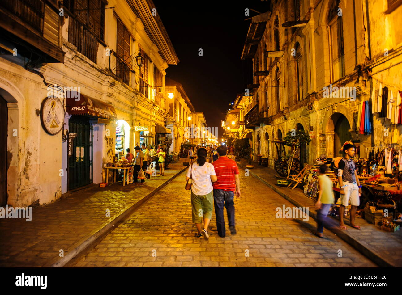 Night shot of the pedestrian zone with Spanish colonial architecture in Vigan, UNESCO Site, Northern Luzon, Philippines - Stock Image