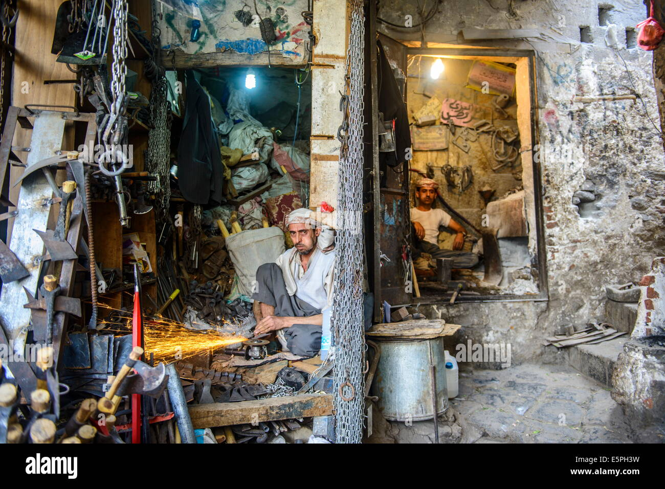 Small workplaces for smiths in the Old Town, UNESCO World Heritage Site, Sanaa, Yemen, Middle East - Stock Image