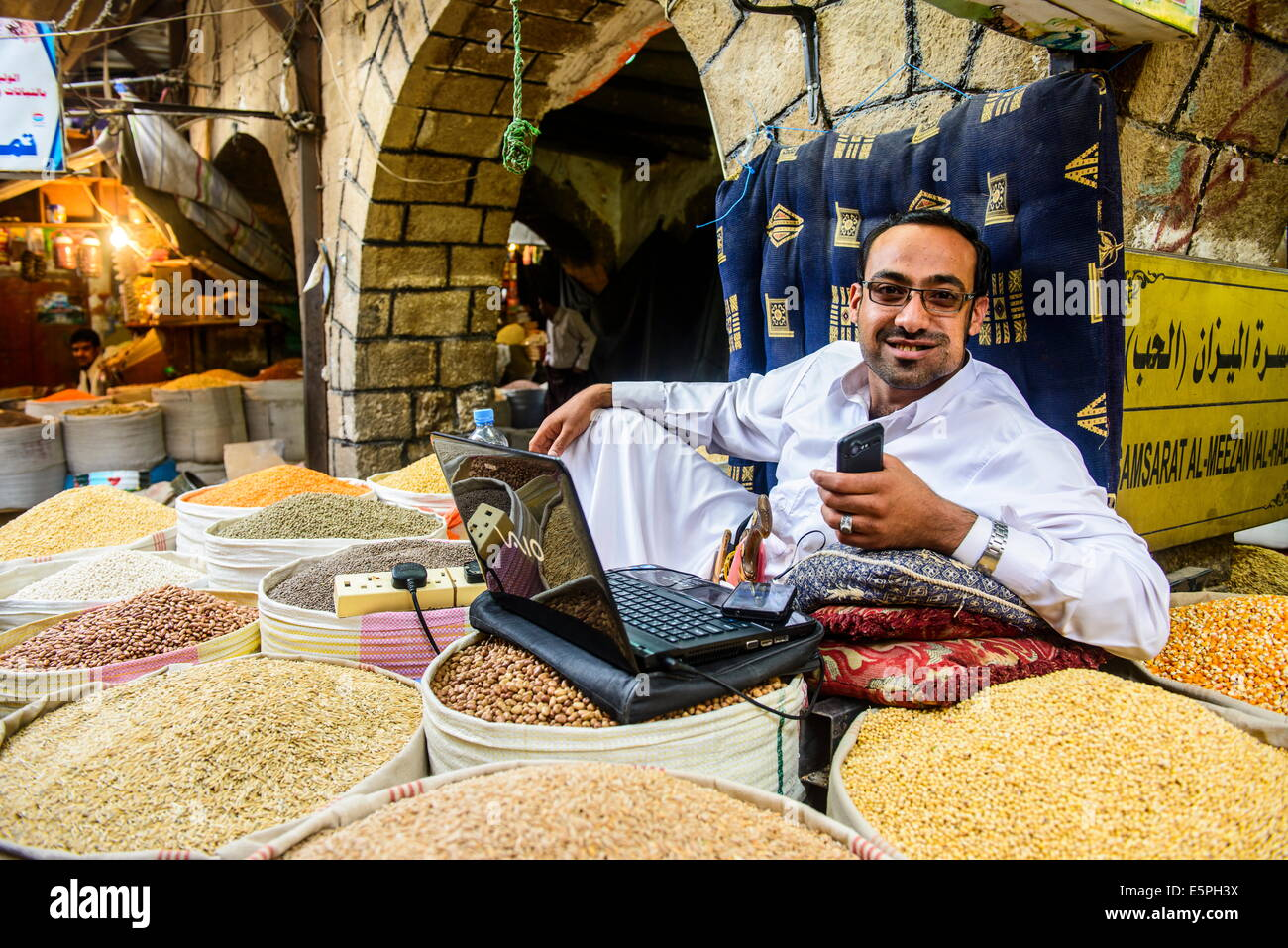 Shopkeeper at the spice market in the Old Town, UNESCO World Heritage Site, Sanaa, Yemen, Middle East - Stock Image