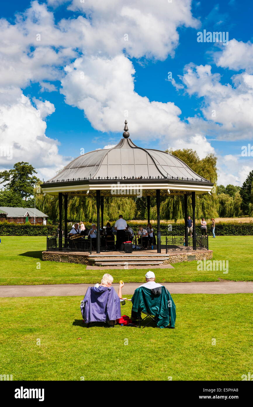 People watching a performance at the bandstand, Godalming, Surrey, England, United Kingdom, Europe - Stock Image