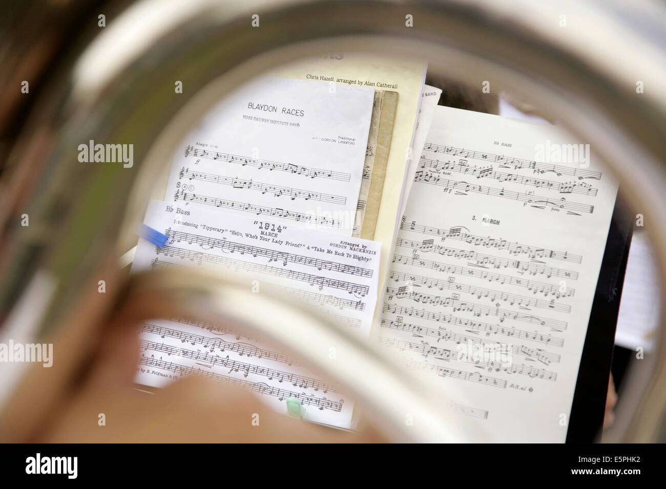 Brass bandsman with sheet music for the Blaydon Races, Tipperary and others. - Stock Image