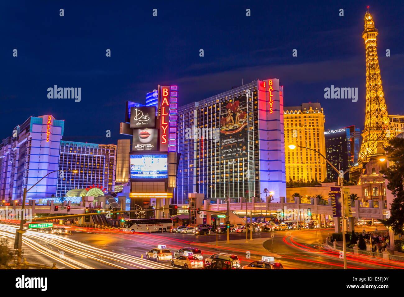 Neon Lights On Las Vegas Strip With Car Headlights Leaving Light Streaks In  Front Of Paris And Ballys, Las Vegas, Nevada, USA