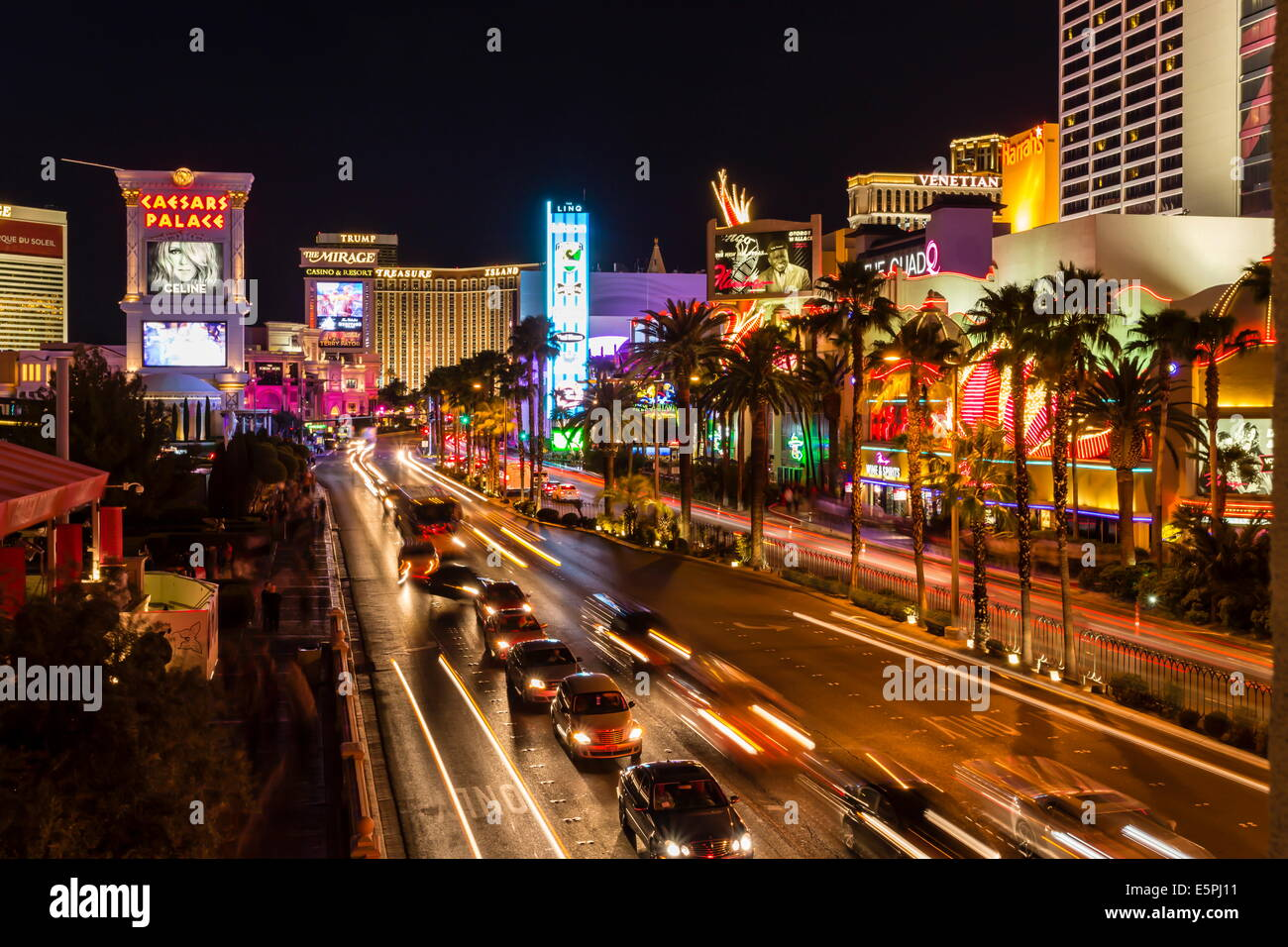 Neon lights, Las Vegas Strip at night with light streaks in front of Caesars, Mirage and Flamingo, Las Vegas, Nevada, - Stock Image