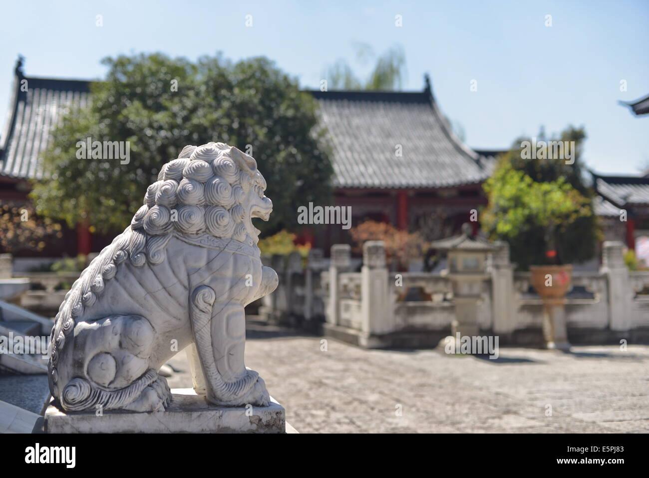 Stone lion in Mufu area, Lijiang, Yunnan, China, Asia - Stock Image