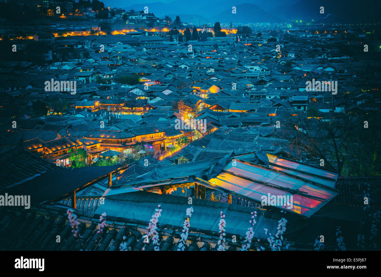 Blue hour shot over roofs of Lijiang Old Town, UNESCO World Heritage Site, Lijiang, Yunnan, China, Asia - Stock Image
