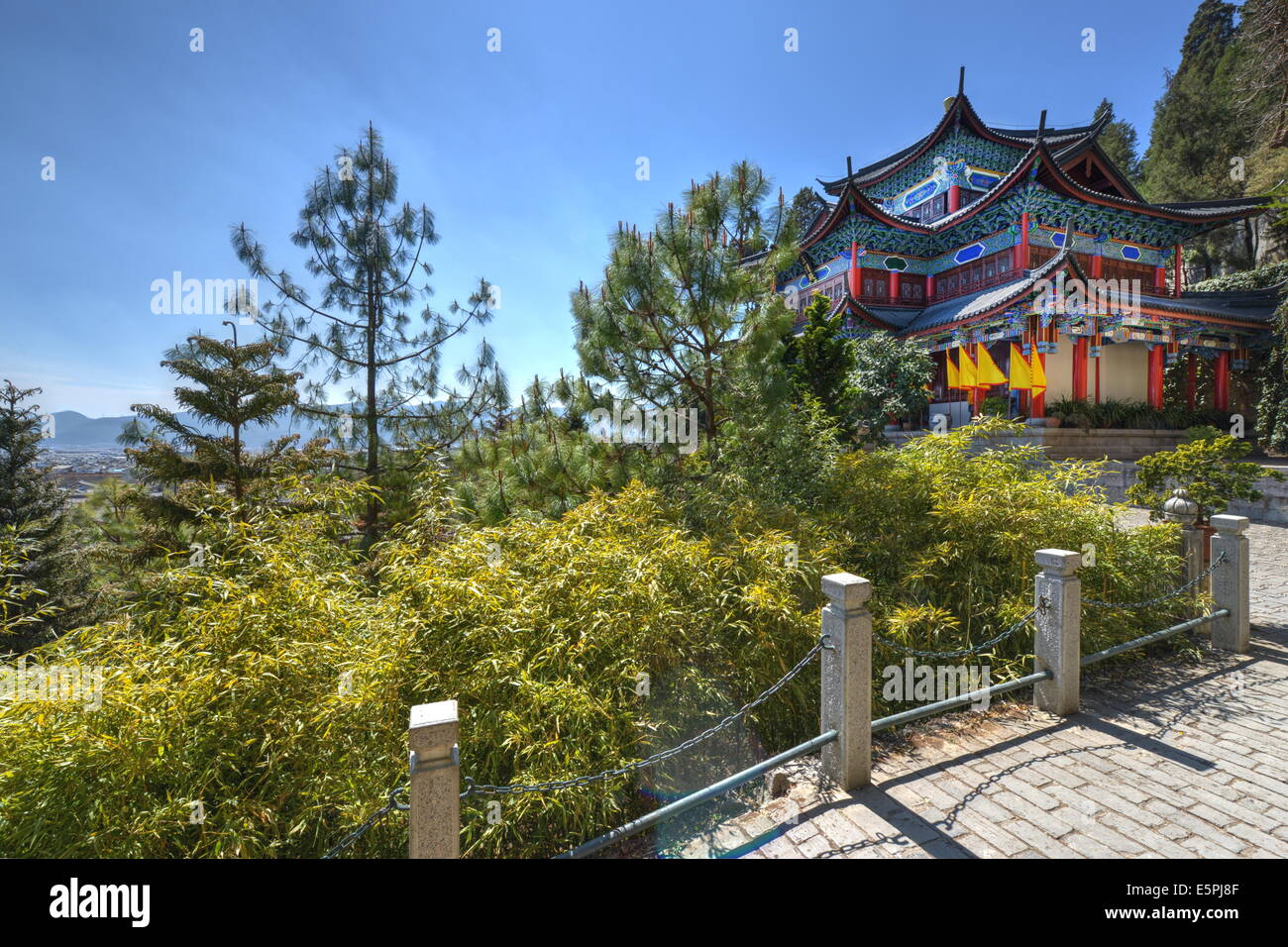 Temple and vegetation in Lijiang, part of the Mufu Wood Mansion complex, Lijiang, Yunnan, China, Asia - Stock Image