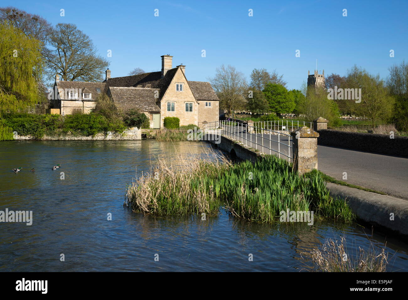 Waiten Hill Farm Cottages on the River Coln, Fairford, Cotswolds, Gloucestershire, England, United Kingdom, Europe - Stock Image