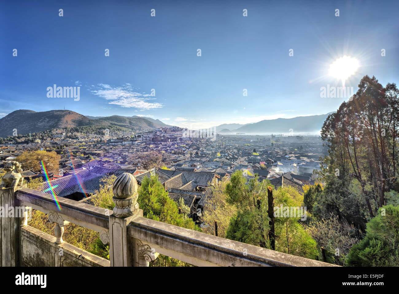 Dayan, the Old Town of Lijiang, and the hill towards the left is Xiangshan (Elephant Hill), Lijiang, Yunnan, China, - Stock Image