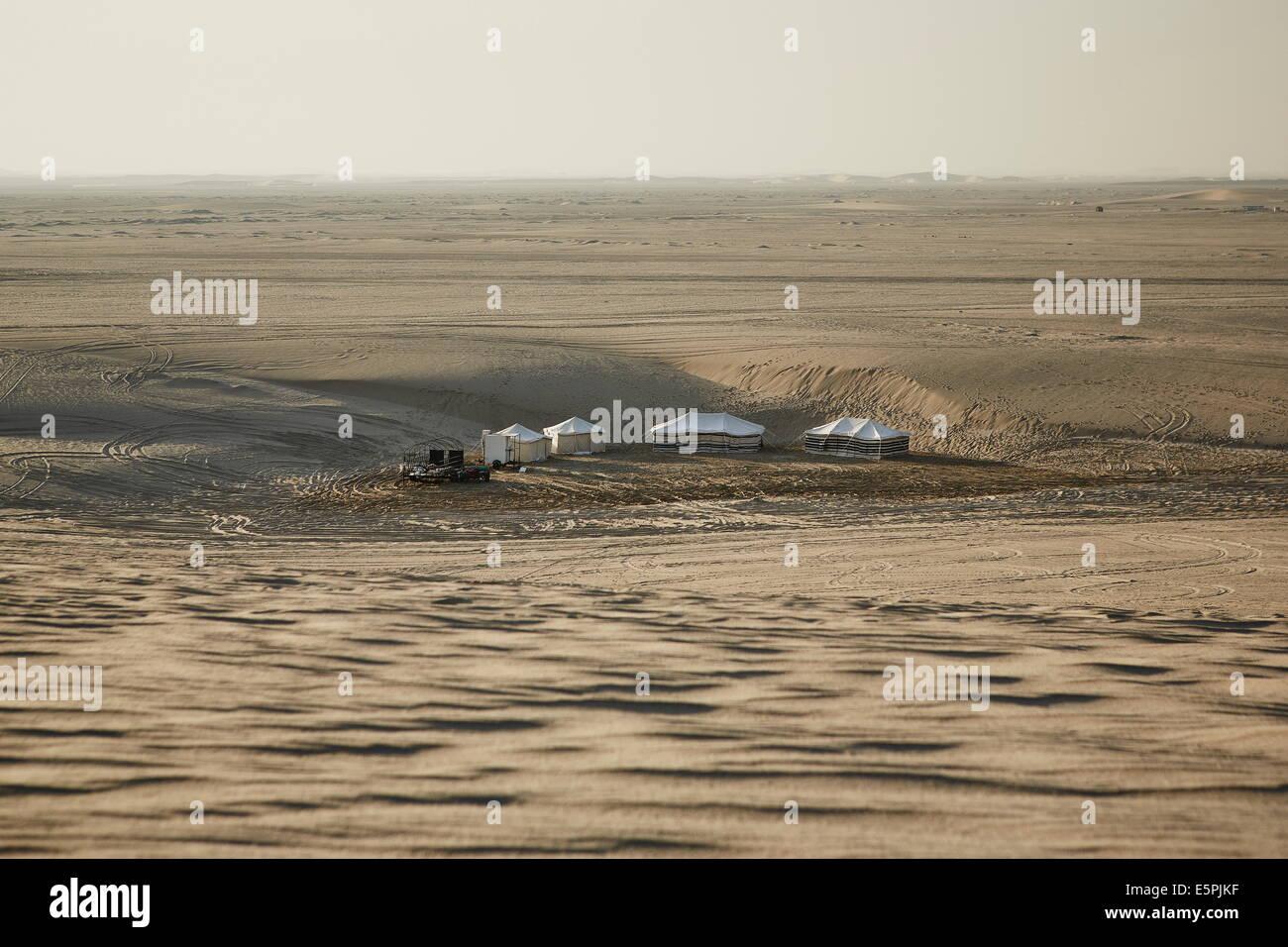 Settlements in the Qatari desert, nomadic culture still evident in the desert, Qatar, Middle East - Stock Image