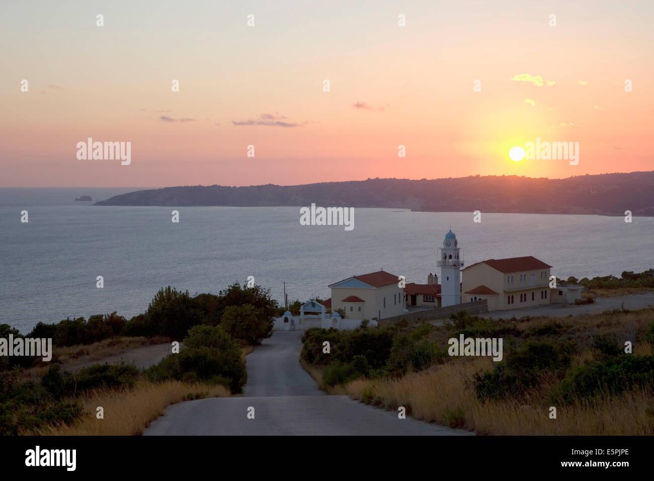 Sunset over Lourdata Bay, near Lourdata, Kefalonia (Kefallonia, Cephalonia), Ionian Islands, Greek Islands, Greece - Stock Image