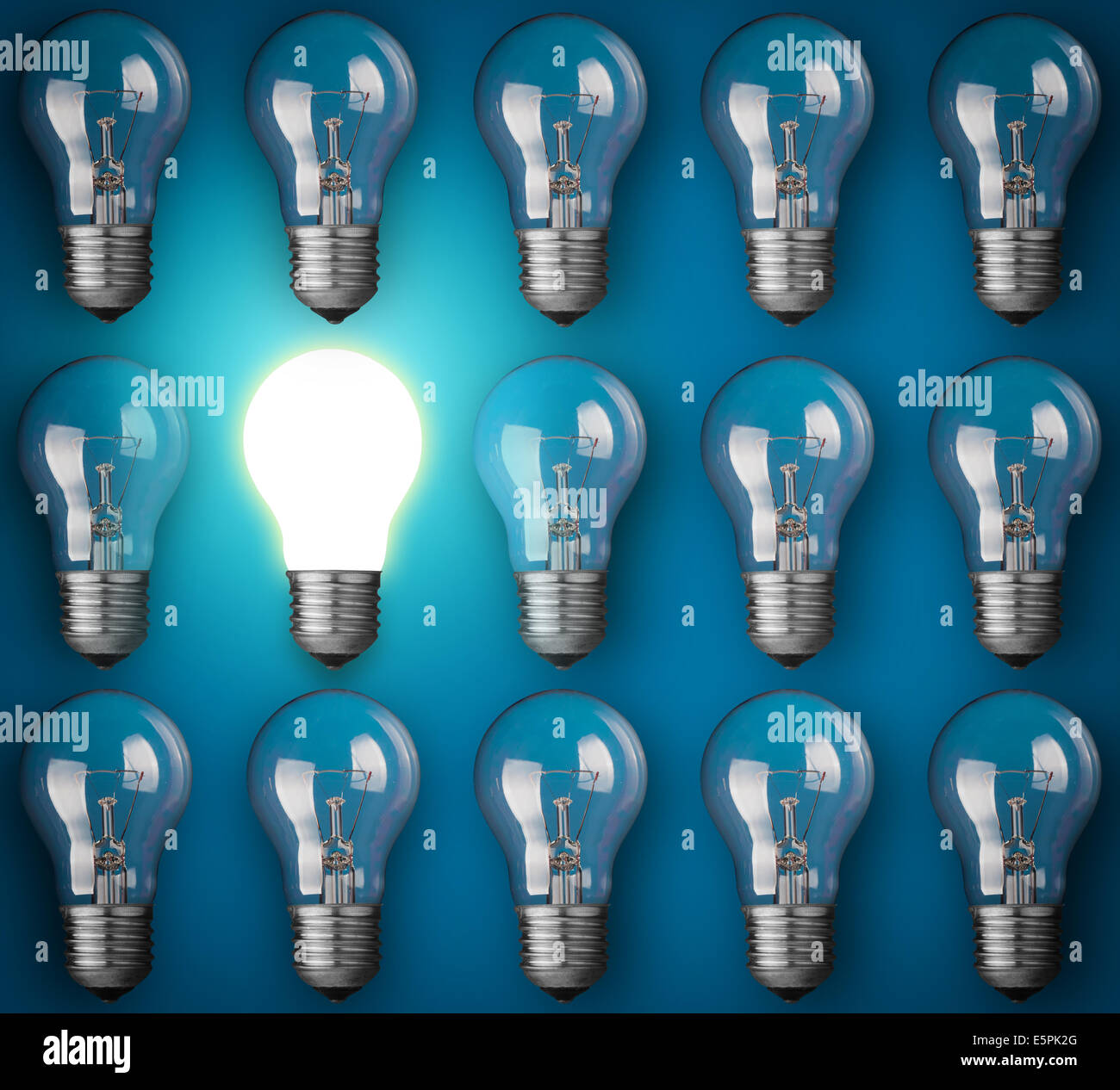 Idea concept with light bulbs on blue background - Stock Image